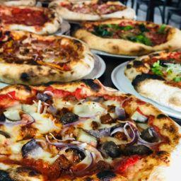 2 pizza especiales y gratis 1 bebida 1.5