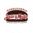Juan y Medio background